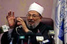 Egyptian-born cleric Sheikh Yussef al-Qaradawi talks during a news conference in Algiers